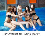 girls relaxing in pool with...   Shutterstock . vector #654140794