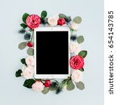 flat lay floral frame with... | Shutterstock . vector #654143785