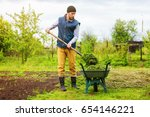 male gardener is filling... | Shutterstock . vector #654146221