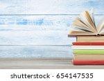open book  hardback books on... | Shutterstock . vector #654147535