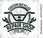 vintage bicycles repair shop... | Shutterstock .eps vector #654154027