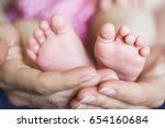 baby's feet in hands   Shutterstock . vector #654160684