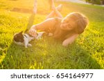 young woman with cat outdoors | Shutterstock . vector #654164977