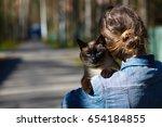 Girl Walking With Cat Outdoor....