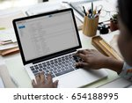 woman using laptop for checking ... | Shutterstock . vector #654188995