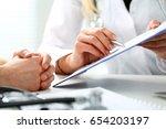female doctor hand hold silver... | Shutterstock . vector #654203197