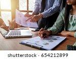 business team meeting present... | Shutterstock . vector #654212899