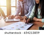 business team analyzing income... | Shutterstock . vector #654213859