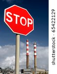 Petrol refinery with STOP sign in foreground - Energy waste concept. - stock photo