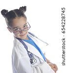 Small photo of An elementary girl playing doctor/nurse looking over her glasses at the viewer with a smug smile. On a white background.
