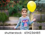 smiling little girl with yellow ... | Shutterstock . vector #654236485