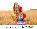 happy couple having fun... | Shutterstock . vector #654239701