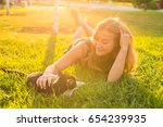 young happy smiling woman with... | Shutterstock . vector #654239935