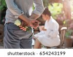 the secret of love. a young man ... | Shutterstock . vector #654243199
