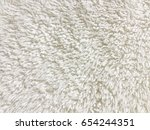 closeup of cream carpet texture | Shutterstock . vector #654244351