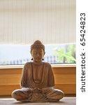 Wooden buddha - stock photo