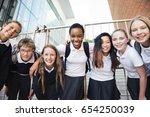 group of students huddle... | Shutterstock . vector #654250039