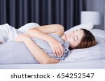 woman sleeping with bolster... | Shutterstock . vector #654252547