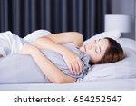 woman sleeping with bolster... | Shutterstock . vector #654252547