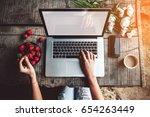 workspace with girl's hands ... | Shutterstock . vector #654263449
