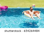 caucasian tattooed man floating ... | Shutterstock . vector #654264484