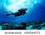 girl scuba diver diving on... | Shutterstock . vector #654264571