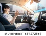 young woman riding autonomous... | Shutterstock . vector #654272569