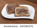 hazelnut chocolate spread on... | Shutterstock . vector #654284191
