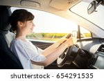 young woman driving a car. | Shutterstock . vector #654291535