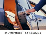 Stock photo close up image of a man opens car s door 654310231