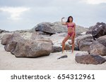 a sexy dark tanned skinned...   Shutterstock . vector #654312961