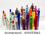 colorful pens in white... | Shutterstock . vector #654355861