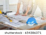 group of engineer checking the... | Shutterstock . vector #654386371