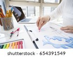 designer who adds lines on the... | Shutterstock . vector #654391549