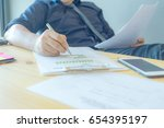 Small photo of A businessman is preparing to summarize data for the annual report. Concept business and financial in cool tone.