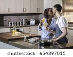 happy mixed race couple cooking ... | Shutterstock . vector #654397015