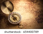 retro compass with vintage map | Shutterstock . vector #654400789