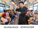 asian businessman calling... | Shutterstock . vector #654414184