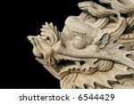 Carved dragon on black background - stock photo