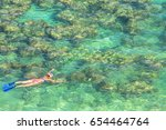 woman snorkeling over coral... | Shutterstock . vector #654464764