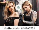 tattoo artist in a studio | Shutterstock . vector #654466915