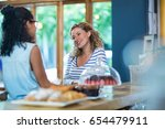 female friends interacting with ... | Shutterstock . vector #654479911