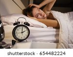 clock show 2 o'clock and woman... | Shutterstock . vector #654482224
