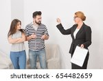 realtor proposing to sign a... | Shutterstock . vector #654482659