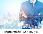 double exposure businessman ... | Shutterstock . vector #654487741