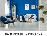 trendy blue and white living...