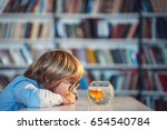 little child with goldfish | Shutterstock . vector #654540784
