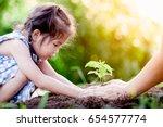 asian little girl and parent... | Shutterstock . vector #654577774