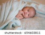 baby on bed in room. | Shutterstock . vector #654603811
