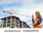 construction engineer working... | Shutterstock . vector #654605995